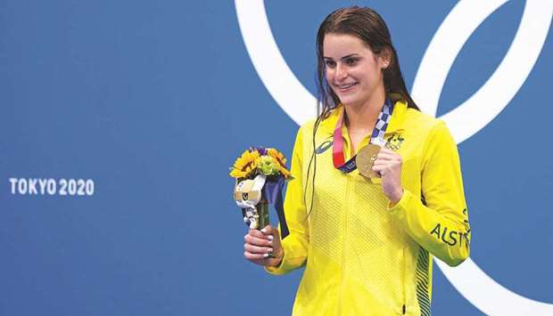 Australia's Kaylee McKeown poses with her medal on the podium after the final of the women's 100m ba