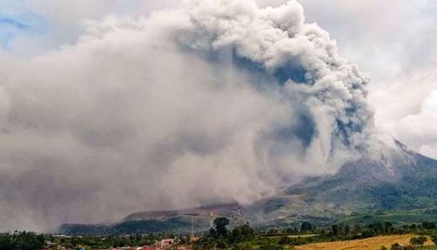 Mount Sinabung erupts spewing a massive column of smoke and ash as seen from Karo, North Sumatra, on