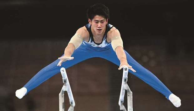 Japan's Daiki Hashimoto competes in the parallel bars during the men's all-around final at the Tokyo