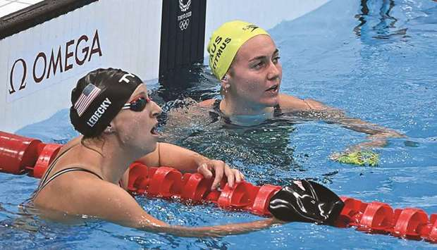 Australia's Ariarne Titmus (right) reacts next to USA's Kathleen Ledecky after winning the final of
