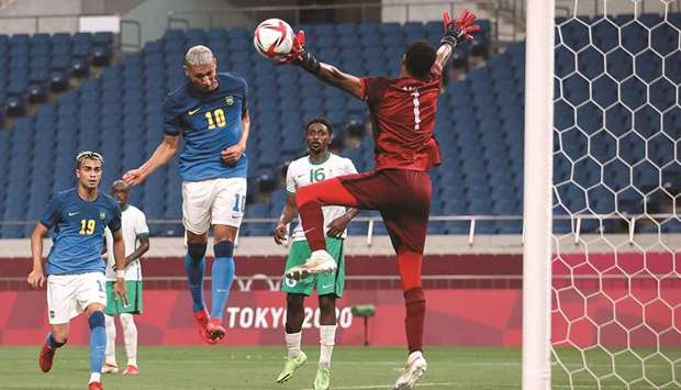 Brazil's Richarlison (centre) scores against Saudi Arabia in their Group D match at the Saitama Stad