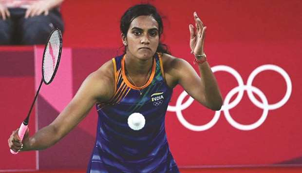 India's PV Sindhu hits a shot to Denmark's Mia Blichfeldt in their round of 16 match during the Toky