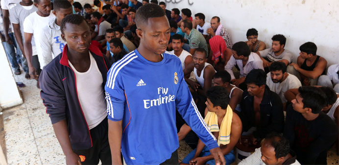 Migrants rescued by Libyan coastguard after their boat sank
