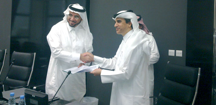 Ibrahim Almuftah and Alkhorayef Group commercial manager Mohamed Alkhorayef shaking hands after sign