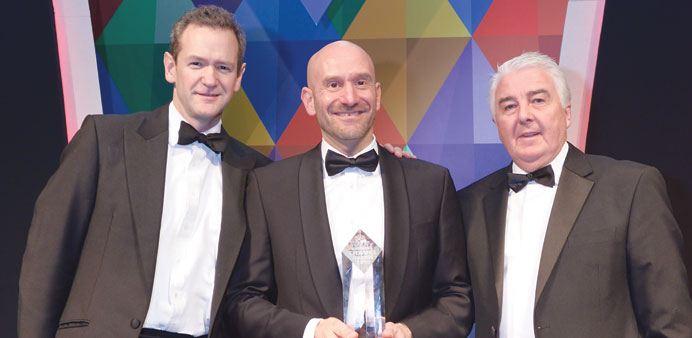 "A Qatar Airways executive with the ""Best long-haul airline"" award at the 18th annual Business Travel"