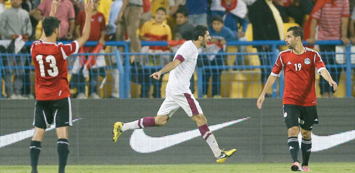 Qatar's Majed Ibrahim (Centre) celebrates scoring a goal during their international friendly soccer
