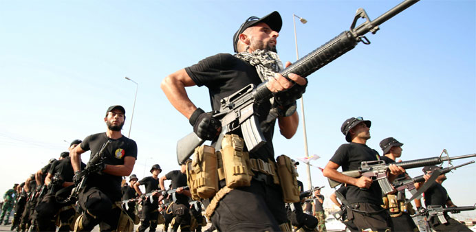 Fighters march during a military parade in the southern Iraqi city of Basra