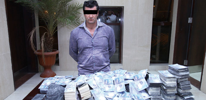 The suspect in the fake currency case with the notes recovered from him.