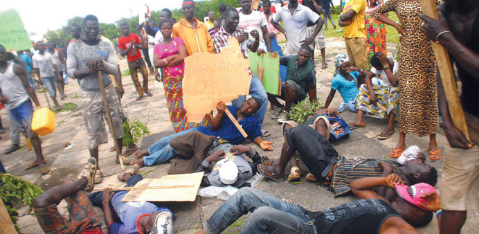 Demonstrators protest outside parliament in Accra after city authorities demolished shanties as part