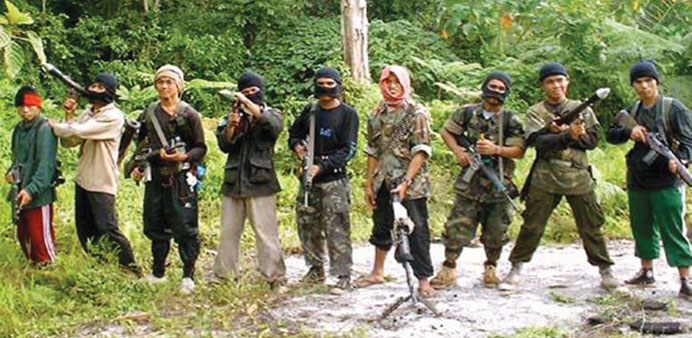 Abu Sayyaf insurgents pose in the jungle.