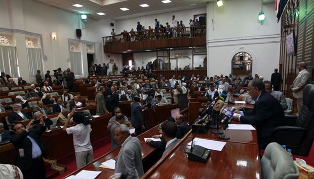 Members of Yemen's parliament attend a parliament session in the rebel-held capital Sanaa.