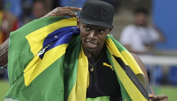 Bolt 'the greatest' bows out with nine golds