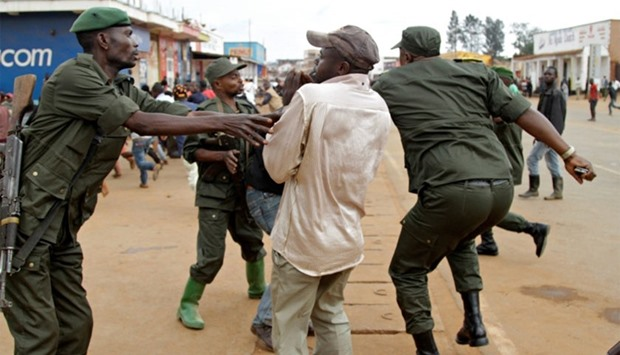 Congolese soldiers arrest civilians protesting against the government's failure to stop the killings