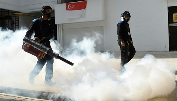 Pest control staff fumigate at Macpherson housing estate in Singapore