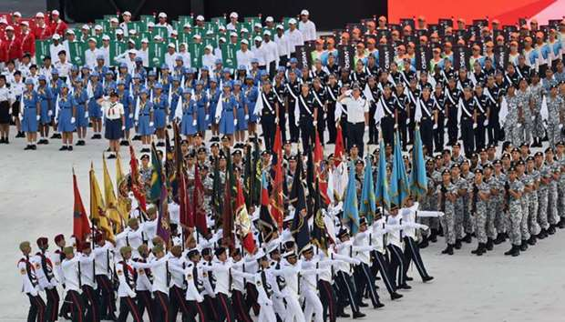 Members of various branches of the armed forces march in during the 52nd Singapore National Day para