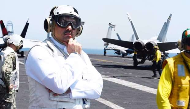 HE the Minister of State for Defence Affairs Dr Khalid bin Mohamed al-Attiyah on board USS Nimitz