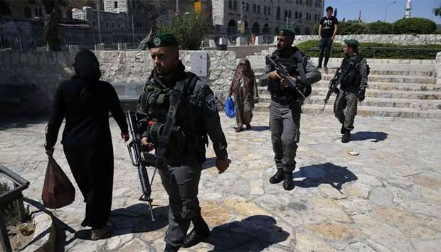 Israeli police walk outside Damascus Gate in Jerusalem's Old City