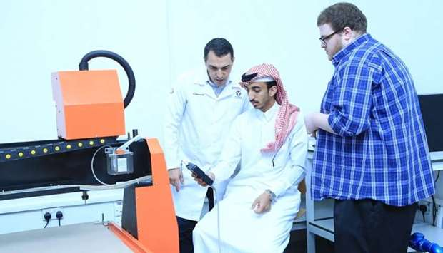 Participants learn to operate equipment during the workshop.