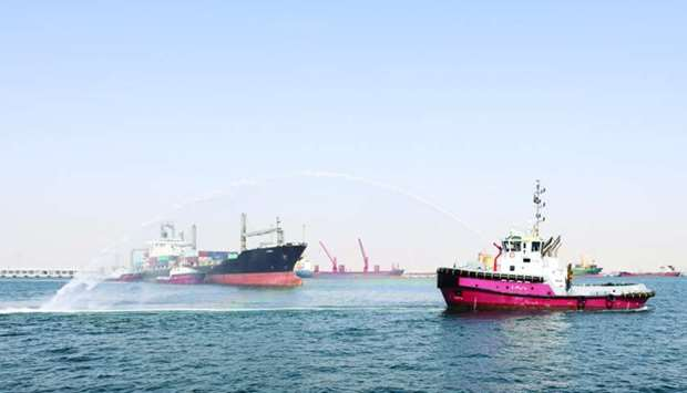 The first weekly direct container vessel service from Karachi Port being received with a water salut