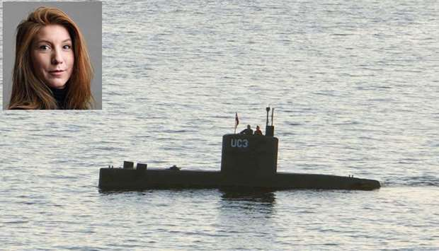 """Allegedly Swedish journalist Kim Wall stands next to a man in the tower of the private submarine """"UC"""