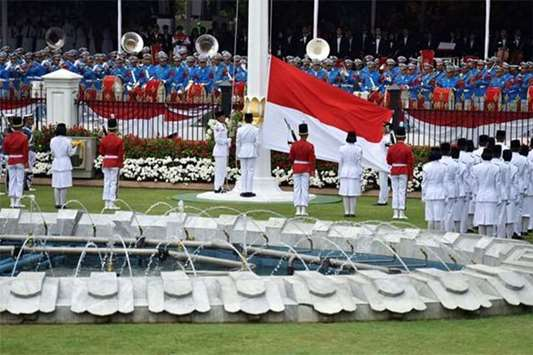 The Indonesian national flag is raised during a ceremony to mark Independence Day in Jakarta