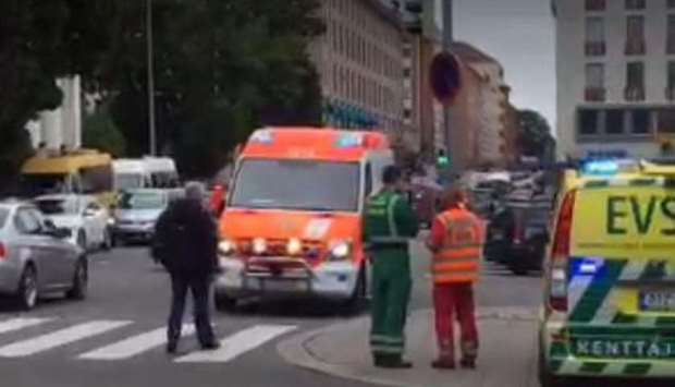 A video grab taken from Twitter shows officials standing in a street in the Finnish city of Turku wh