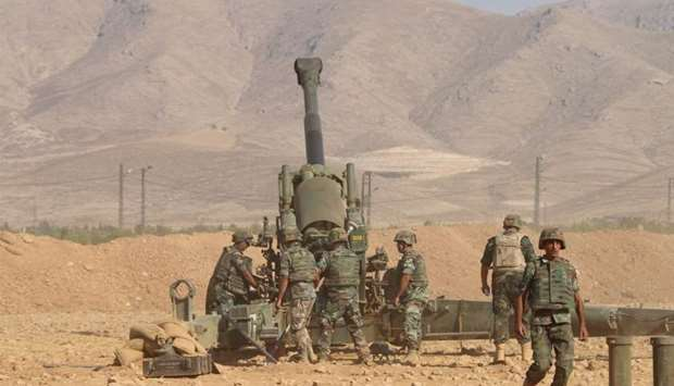 Lebanese army holding a position in a mountainous area against jihadist fighters