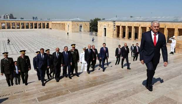 Turkish Prime Minister Binali Yildirim attends a wreath-laying ceremony with members of the Supreme