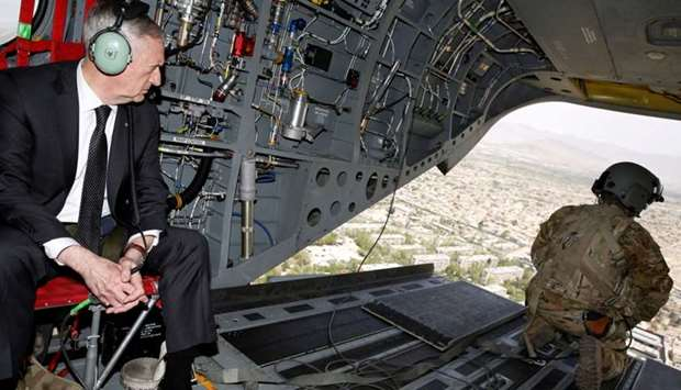 US Defense Secretary James Mattis looks out over Kabul as he arrives via helicopter at Resolute Supp