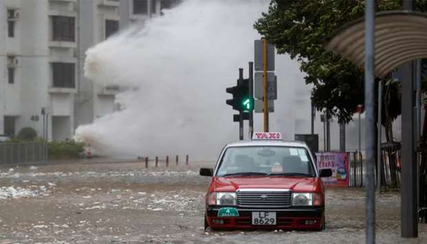Waves triggered by Typhoon Hato are seen in Hong Kong