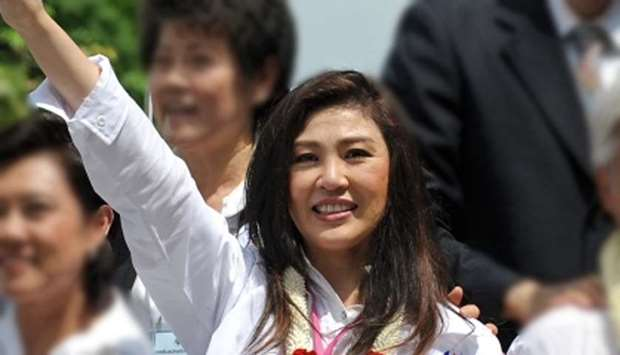 Former Thai PM Yingluck turns to Buddhism ahead of Friday verdict
