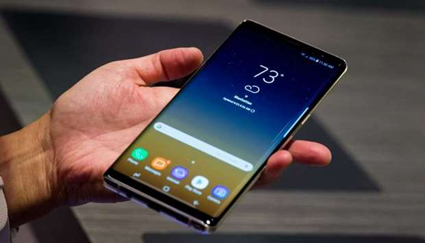 A man tries the new Samsung Galaxy Note8 smartphone during a launch event, August 23, 2017 in New Yo