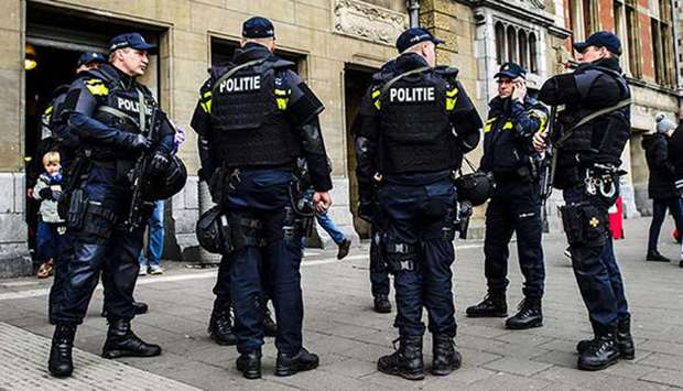 Dutch police officers patrol at the Central Station in Amsterdam