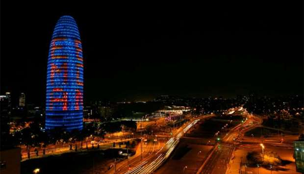 "The Agbar tower is illuminated with ""EMA BCN"" presenting their candidature to move the European Medi"