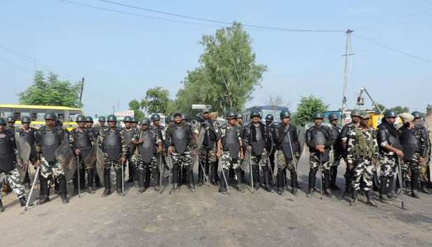 Indian police in riot gear gather to confront followers of Gurmeet Ram Rahim Singh, the controversia