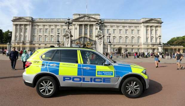 A police vehicle patrols outside Buckingham Palace in London
