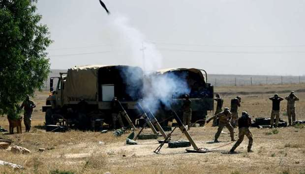 Members of Iraqi Army fire mortar shells during the war between Iraqi army and Shia Popular Mobiliza