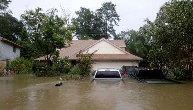 Houses and cars are seen partially submerged by flood waters from tropical storm Harvey in east Hous
