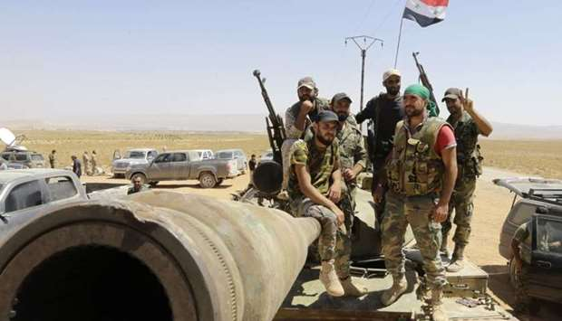 Syrian army fighters stand guard in the Qara area, in Syria's Qalamoun region