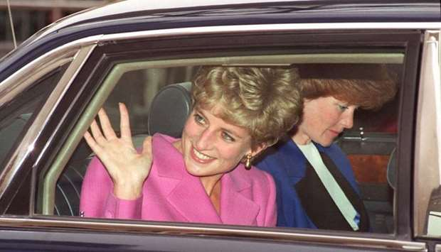Diana waving to the crowd as she arrives at the Cite de la Musique at La Villette in Paris. File pho