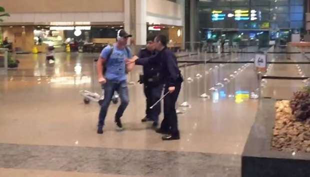 Drunk Australian assaults police at Singapore Airport