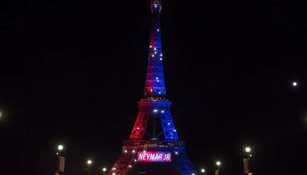 "Red and blue lights and a welcoming message that reads in French ""Neymar Jr."" adorn the Eiffel Tower"