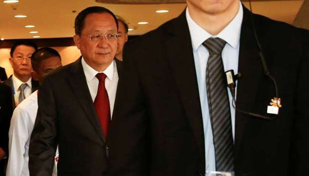 North Korean Foreign Minister Ri Yong-ho (L) walks toward an escalator during 50th ASEAN Foreign Min