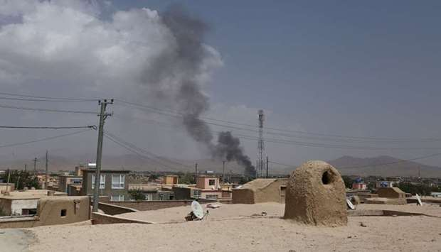 Smoke rising into the air after Taliban militants launched an attack on the Afghan provincial capita