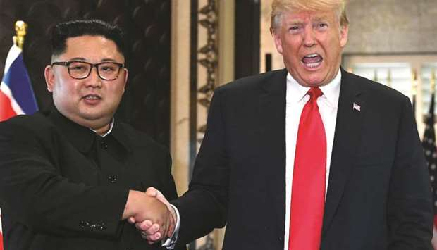 Kim Jong-un meeting Donald Trump during their historic summit in Singapore on June 12, 2018.