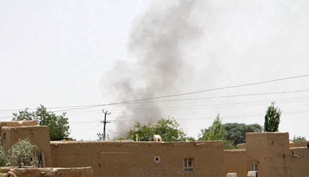 Smoke rises from a residential area where gun battle is going on between Taliban and Afghan forces i