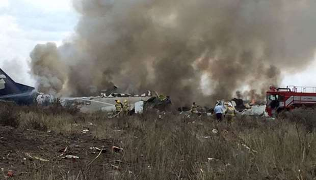 Rescue personnel work at the site where an Aeromexico-operated Embraer passenger jet crashed in Mexi