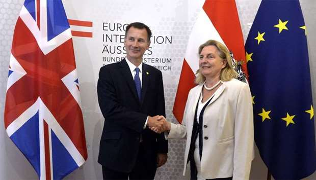 Britain's Foreign Minister Jeremy Hunt shakes hands with Austria's Foreign Minister Karin Kneissl