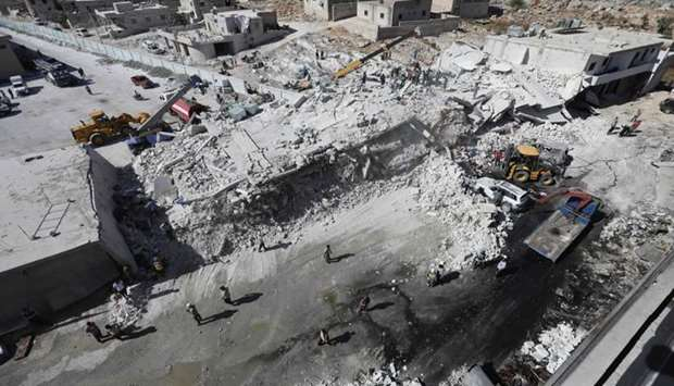 Destroyed buildings following an explosion at an arms depot in a residential area in Syria's Idlib