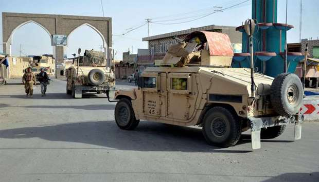 Afghan security guards during a Taliban attack in Ghazni city, Afghanistan